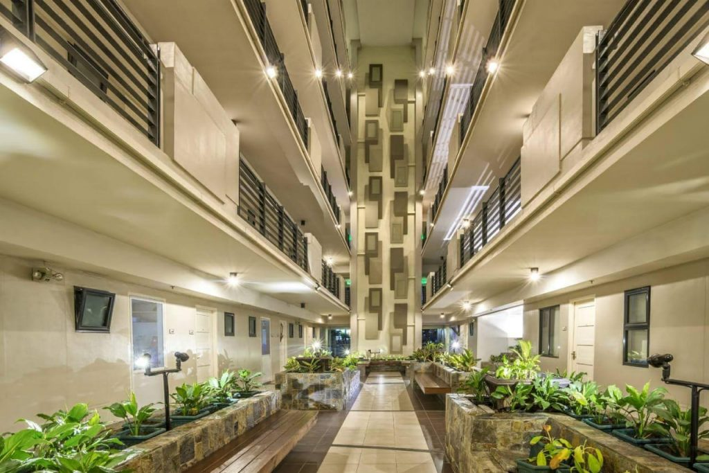 Spacious single loaded corridors inside MULBERRY PLACE buildings.